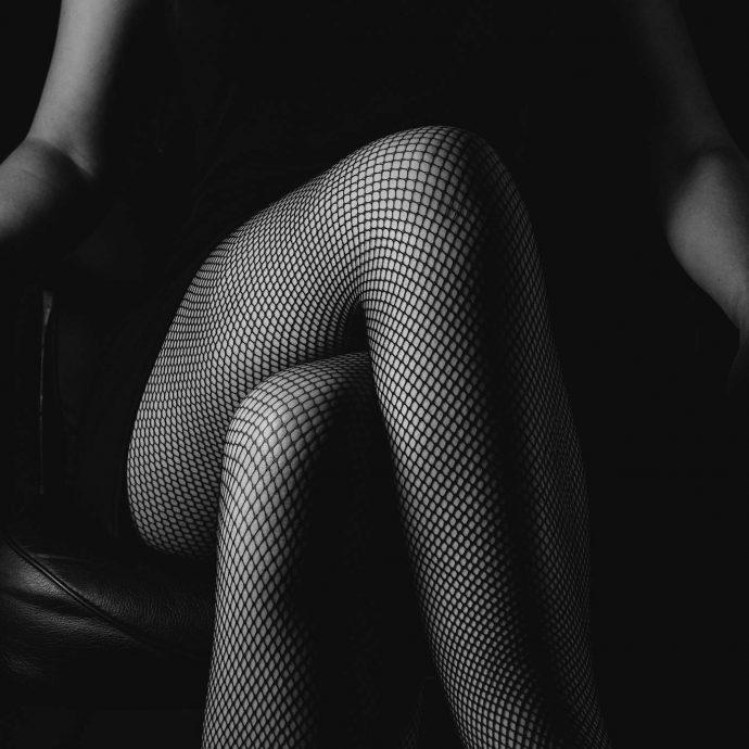 Scarlet Girl in black fishnet stockings